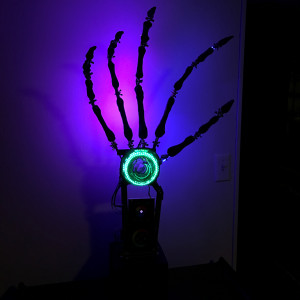Hand of Doom Metal, glass, plastic, wood and electronics create a 45 inch tall glowing hand with jointed fingers that can produce dim colored light (as seen in pic) or bright illuminating white light.
