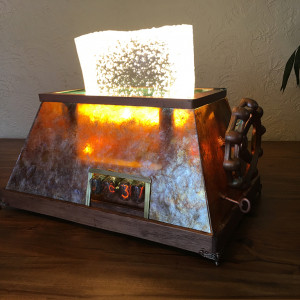 Cosmic Toaster - Mica, metal, wood, electronics and vintage Russian nixie tubes create a highly adjustable light and clock.