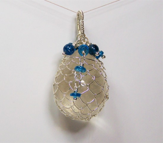 Netted Clear Quartz Egg With Apatite Pendant
